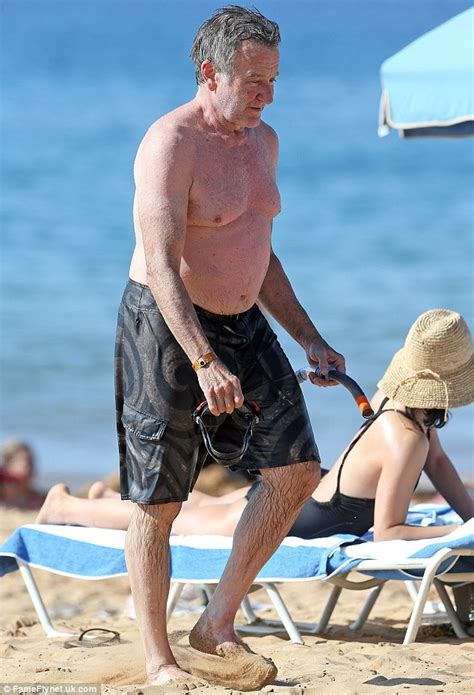 Comedian Robin Williams works off his holiday weight gain