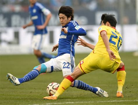 Japan pin-up Uchida returns home after Germany spell