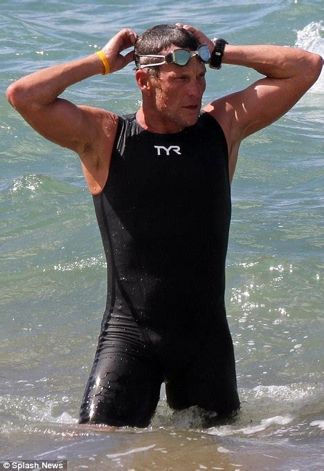Lance Armstrong flexes his impressive muscles before