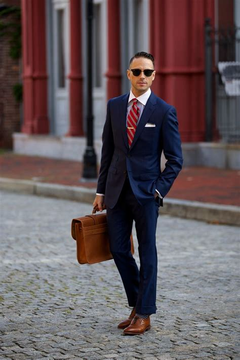Power blue suit, walnut shoes, red tie